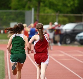 Girls running on track